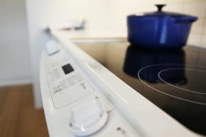 blue pot on glass top stove
