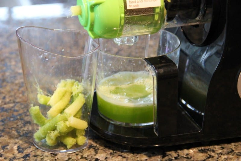 juicing celery with an Aicok slow masticating juicer
