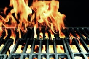 flames over grill grates